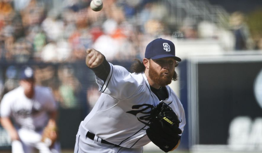 San Diego Padres starting pitcher Ian Kennedy throws against the San Francisco Giants in the first inning of a baseball game Thursday, April 9, 2015, in San Diego.   (AP Photo/Lenny Ignelzi)