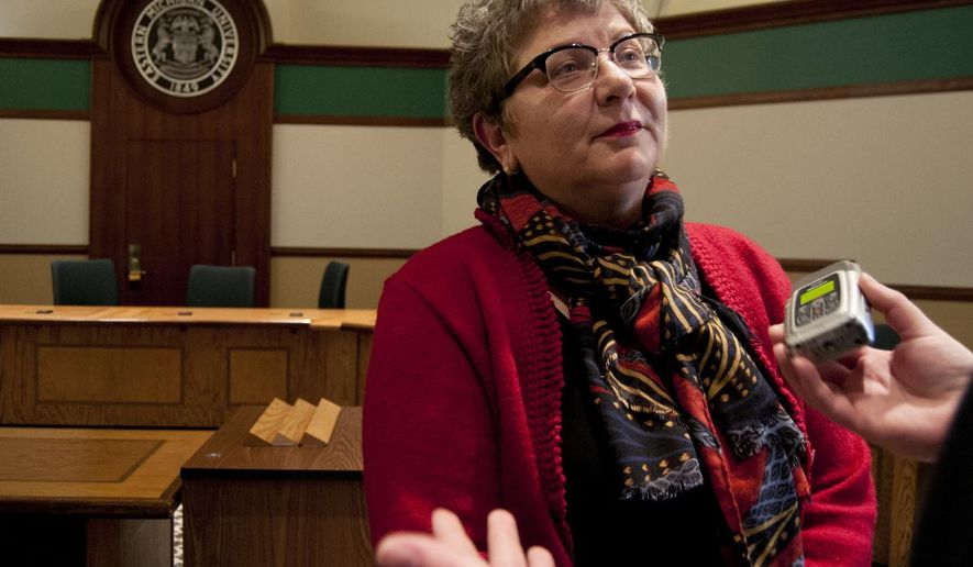 Kim Schatzel speaks to a reporter after the announcement on Thursday, April 9, 2015, that she will become interim president when Susan Martin steps down from her post in July. (AP Photo/The Ann Arbor News, Nicole Hester) LOCAL TV OUT; LOCAL INTERNET OUT