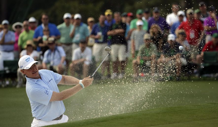 Ernie Els, of South Africa, chips to the 17th green during the first round of the Masters golf tournament Thursday, April 9, 2015, in Augusta, Ga. (AP Photo/Chris Carlson)