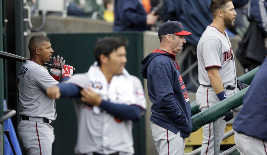 Minnesota Twins manager Paul Molitor, second from right, watches from the dugout during the fourth inning of a baseball game against the Detroit Tigers, Thursday, April 9, 2015, in Detroit. (AP Photo/Carlos Osorio)