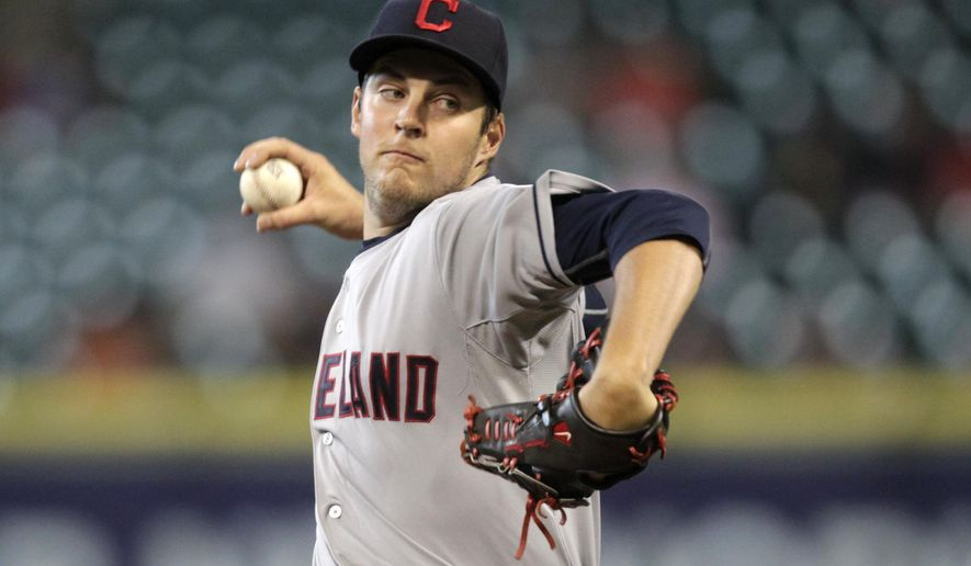 Cleveland Indians pitcher Trevor Bauer throws during the first inning of a baseball game against the Houston Astros, Thursday, April 9, 2015, in Houston. (AP Photo/Patric Schneider)