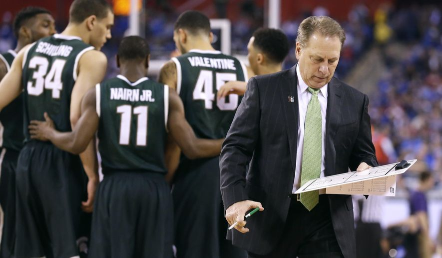 Michigan State head coach Tom Izzo walks back to the bench during the second half of the NCAA Final Four tournament college basketball semifinal game against Duke Saturday, April 4, 2015, in Indianapolis. (AP Photo/Michael Conroy)