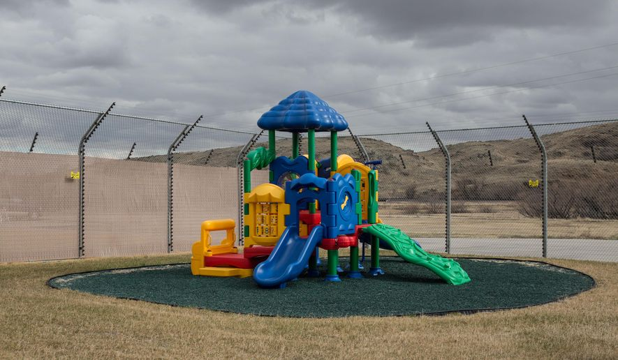 A vacant playground stands in the yard of the Wyoming Women's Center nursery on Wednesday, March 25, 2015, in Lusk, Wyo. Funds were appropriated in 2012 for a $1.2 million renovation to the building housing the nursery, which has yet to open because of shortage of staff at the prison. (AP Photo/Casper Star-Tribune, Ryan Dorgan)