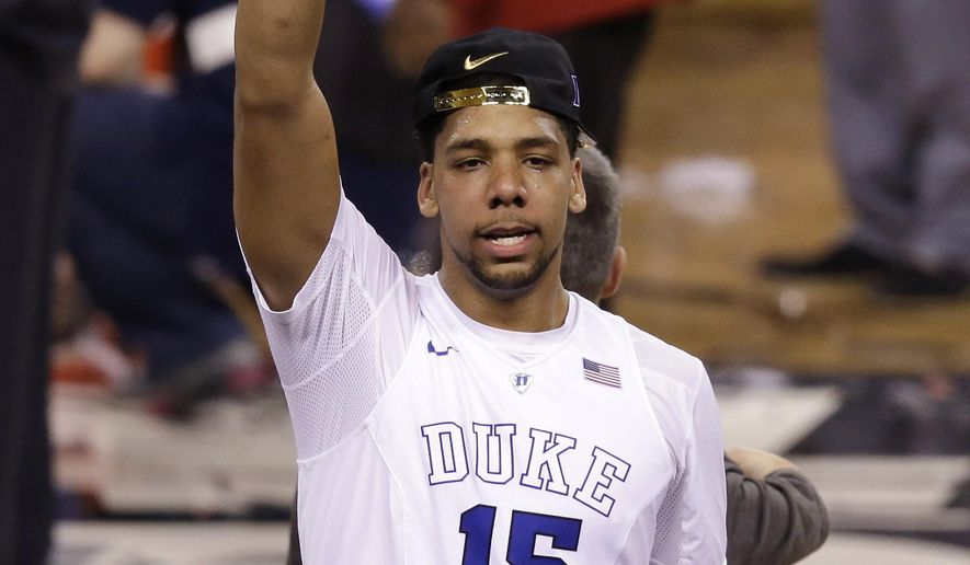 Duke's Jahlil Okafor celebrates after his team's 68-63 victory over Wisconsin in the NCAA Final Four college basketball tournament championship game Monday, April 6, 2015, in Indianapolis. (AP Photo/Darron Cummings)