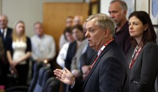 Sen., Lindsey Graham, R-S.C., talks to employees after touring New Hampshire Ball Bearings Thursday April 9, 2015 in Laconia, N.H. Lindsey met with workers to discuss their support of legislation re-authorizing the Export-Import Bank.  (AP Photo/Jim Cole)