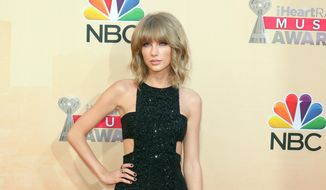 Taylor Swift arrives at the iHeartRadio Music Awards in Los Angeles in this March 29, 2015. Swift revealed to her fans that her mother has cancer in a post on her Tumblr on Thursday, April 9, which her representative confirmed. (Photo by John Salangsang/Invision/AP, File)