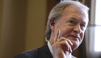 "FILE - In this Dec. 11, 2014 file photo then-Rhode Island Gov. Lincoln Chafee responds to questions during an interview with The Associated Press, in his office at the Statehouse, in Providence, R.I.  Chafee says he has formed an exploratory committee to consider a Democratic presidential campaign, saying in a video that voters want to ""assess the character and experience of those offering ideas."" (AP Photo/Steven Senne, File)"