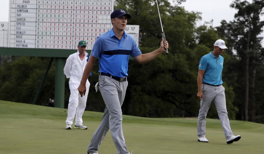 Jordan Spieth reacts after his birdie on the 18th hole during the first round of the Masters golf tournament Thursday, April 9, 2015, in Augusta, Ga. (AP Photo/Chris Carlson)