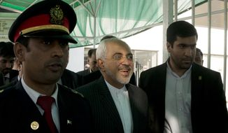 Visiting Iranian Foreign Minister, Mohammad Javad Zarif, center, leaves the Parliament building where Pakistani lawmakers discuss the crisis in Yemen, in Islamabad, Pakistan, Thursday, April, 2015. Zarif is on a two-days visit to Pakistan to discuss the conflict in Yemen, where a Saudi-led air campaign supported by Pakistan is battling Iranian-supported Shiite rebels. (AP Photo/B.K. Bangash)