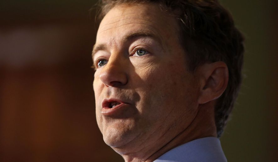 Sen. Rand Paul, Kentucky Republican, is under fire from the NRA due to his support of the NAGR, a rival gun rights advocacy group. (Associated Press)