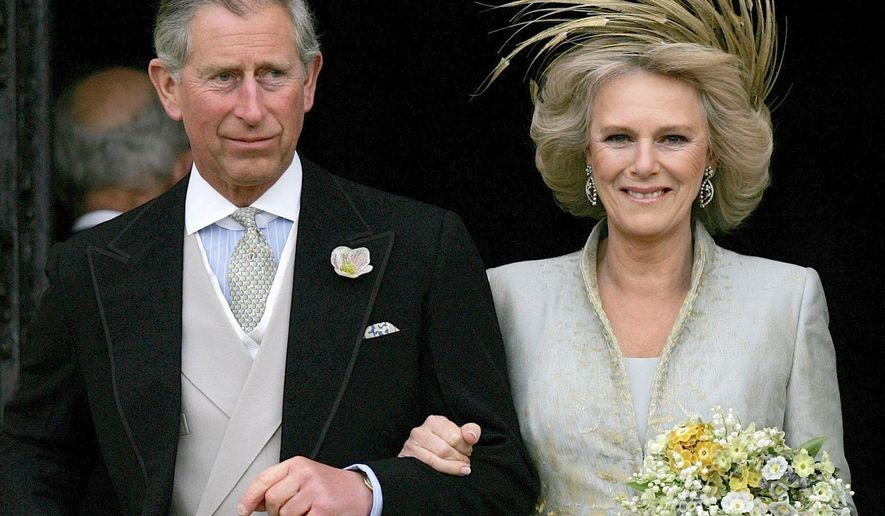 FILE - This is a Saturday, April 9, 2005  file photo of Britain's Prince Charles and his bride Camilla  Duchess of Cornwall as they leave St George's Chaple in Windsor, England following the church blessing of their civil wedding ceremony. The heir to the British throne and his consort, Camilla, are celebrating 10 years of marriage - a decade in which Camilla's public image has gone from aristocratic home-wrecker to admired addition to the royal family. (AP Photo/ Alastair Grant, File)