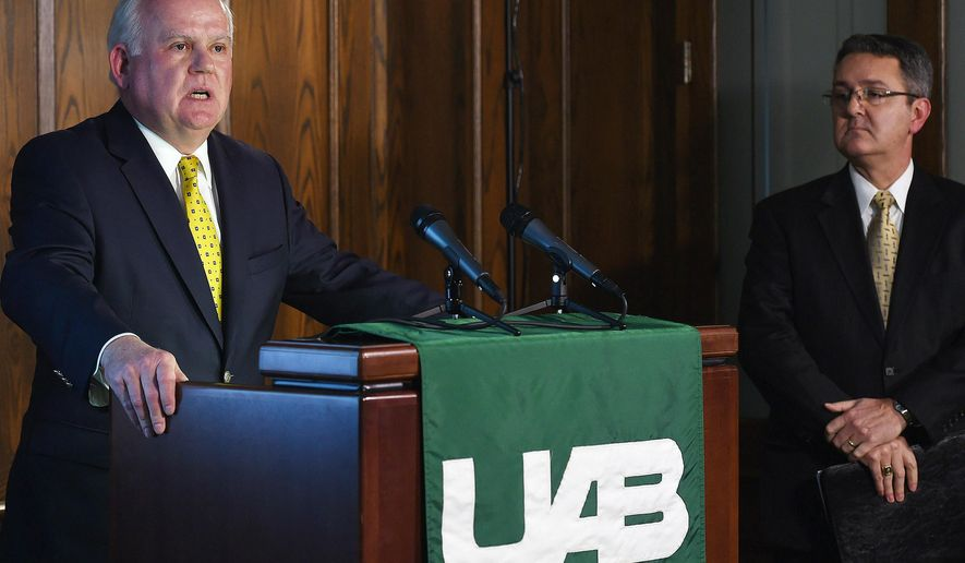 FILE - In this Dec. 2, 2014, file photo, University of Alabama at Birmingham President Ray Watts, left, and UAB Vice President for Financial Affairs and Administration Allen Bolton, right,  address the media during a news conference to discuss the results of their athletics strategic planning process and closing of the UAB football football, rifle, and bowling programs in Birmingham. Ala. Former UAB players are making sure the Blazers get at least one more game at Legion Field. They'll gather Saturday, April 11, 2015,  for the Sons of UAB alumni flag football game.(AP Photo/Tamika Moore, AL.com, File) MAGS OUT