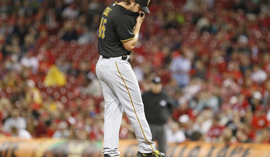 Pittsburgh Pirates' starting pitcher Gerrit Cole reacts to walking Cincinnati Reds' Zack Cozart to load the bases during the fourth inning of a baseball game Wednesday, April 8, 2015, in Cincinnati.  (AP Photo/Gary Landers)