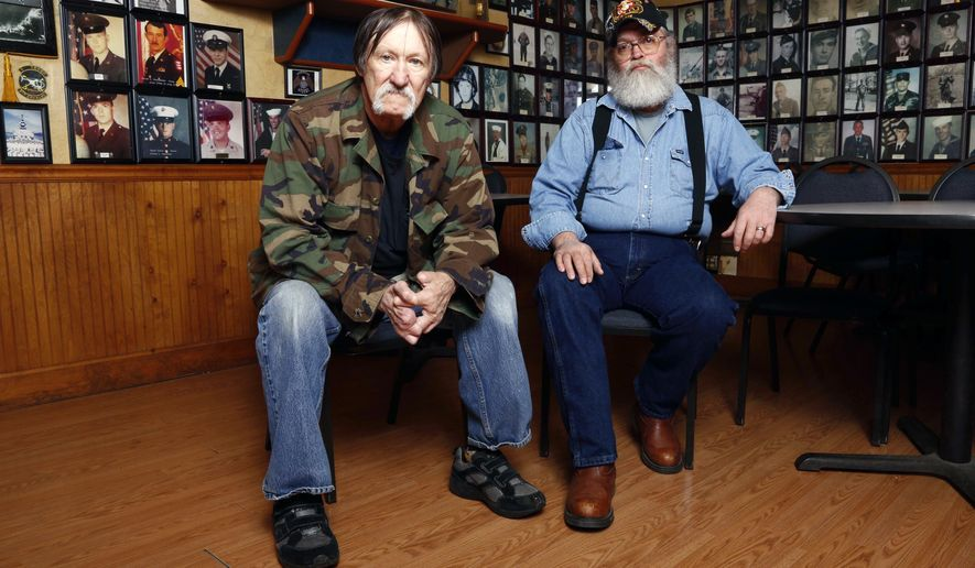 U.S. Air Force veteran Jim Fegan, left, sits with U.S. Marine veteran Tom Davis, right, inside the American Legion Post 471, Monday, March 30, 2015 in Portsmouth, Ohio. Both veterans say they have experienced delays at the Portsmouth VA clinic which was among 100 VA hospitals and clinics across the country with the highest percentages of patients waiting at least 31 days for care. (AP Photo/David Kohl)