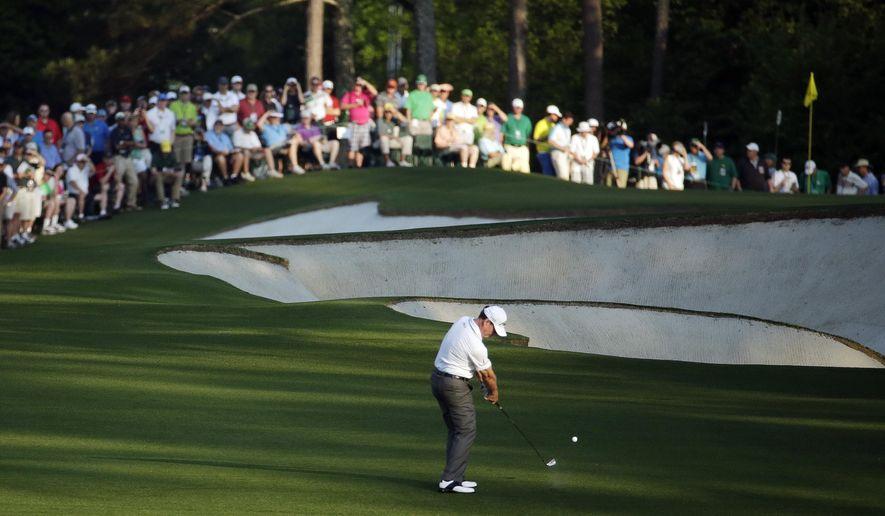 Tom Watson hits on the first fairway during the first round of the Masters golf tournament Thursday, April 9, 2015, in Augusta, Ga. (AP Photo/Charlie Riedel)