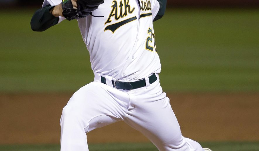 Oakland Athletics starting pitcher Scott Kazmir throws to the Texas Rangers during the sixth inning of a baseball game Wednesday, April 8, 2015, in Oakland, Calif. (AP Photo/Marcio Jose Sanchez)