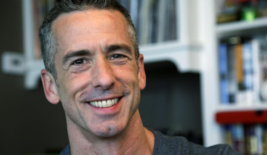 In this May 22, 2013, file photo, author Dan Savage appears at his home in Seattle. (AP Photo/Elaine Thompson, File)