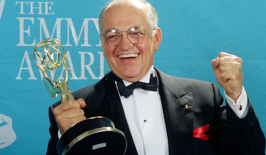 "FILE - In this Aug. 30, 1992 file photo, actor Richard Dysart grasps the Emmy Award he won for Best Supporting Actor in a Drama Series for his role in ""L.A. Law"" during the 44th annual Emmy Awards in Pasadena, Calif. Dysart, a veteran stage and screen actor who played senior partner Leland McKenzie in the long-running courtroom drama ""L.A. Law,"" died at his home in Santa Monica, Calif., on Sunday, April 5, 2015, after a long illness. He was 86. (AP Photo/Doug Pizac, File)"