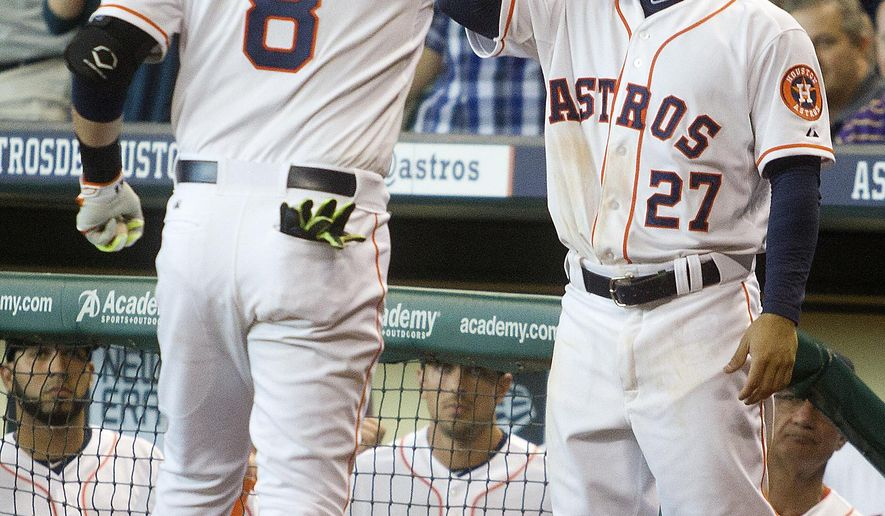 Houston Astros' Jed Lowrie (8) is congratulated by teammate Jose Altuve (27) after hitting a solo home run off of Cleveland Indians pitcher Nick Hagadone to break up a  combined no-hitter during the ninth inning of a baseball game, Thursday, April 9, 2015, in Houston. (AP Photo/Patric Schneider)