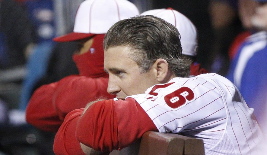 Philadelphia Phillies' Chase Utley looks out to the field from the dugout during the ninth inning of a baseball game against the Boston Red Sox, Thursday, April 9, 2015, in Philadelphia. The Red Sox won 6-2. (AP Photo/Chris Szagola)