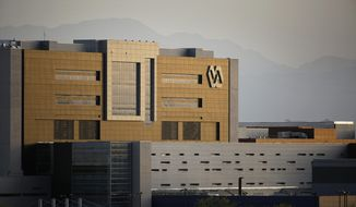 This April 1, 2015, file photo shows the Department of Veterans Affairs medical facility in North Las Vegas. (AP Photo/John Locher) ** FILE **