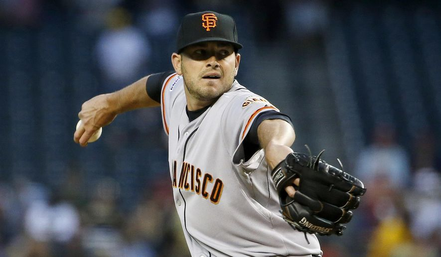 San Francisco Giants' Chris Heston throws a pitch against the Arizona Diamondbacks during the first inning of a baseball game Wednesday, April 8, 2015, in Phoenix. (AP Photo/Ross D. Franklin)