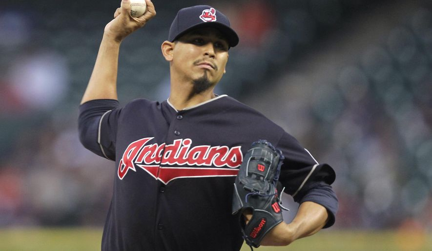 Cleveland's pitcher Carlos Carrasco throws during the first inning of a baseball game against the Houston Astros, Wednesday, April 8, 2015, in Houston. (AP Photo/Patric Schneider)