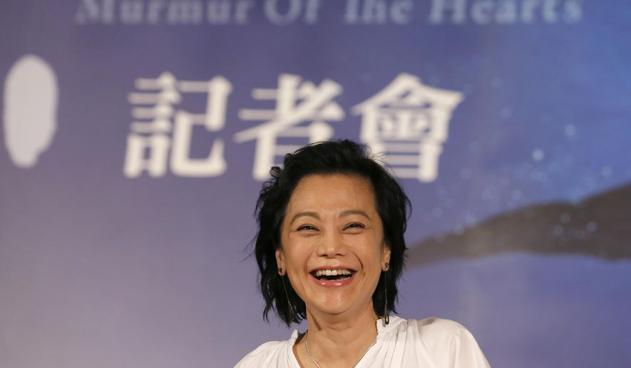 """In this Thursday, April 2, 2015 file photo, Taiwanese director Sylvia Chang laughs off a question during a promotional event for her latest movie """"Murmur of the Hearts"""" in Taipei, Taiwan. Chang is making a comeback after a seven-year hiatus with """"Murmur of the Hearts,"""" which pairs seasoned actors with fresh faces to tell a story about three young people with a broken past struggling with finding compassion in their relationships. """"Everyone make mistakes. Some mistakes, people find them unforgivable but some are forgivable. So how do we find compassions to tolerate them?"""" Chang said last week, calling her movie a tribute to love. (AP Photo/Wally Santana, File)"""