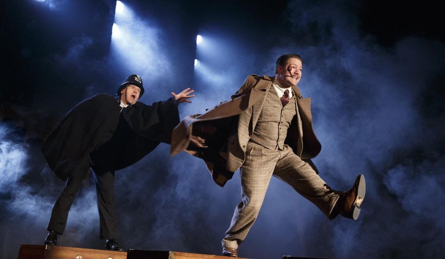 """In this image released by the O and M Company, Billy Carter, left, and Robert Petkoff appear during a performance of """"39 Steps,"""" at The Union Square Theatre in New York. (AP Photo/The O and M Company, Joan Marcus)"""