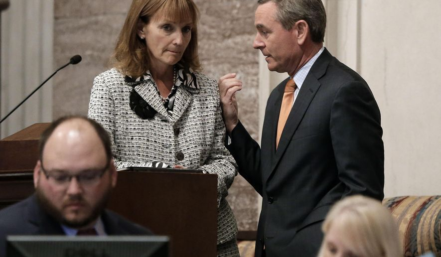 House Speaker Beth Harwell, R-Nashville, left, talks with Rep. Glen Casada, R-Franklin, right, Monday, April 6, 2015, in Nashville, Tenn. The House voted to remove the Tennessee Capitol from a bill to expand the areas where people with handgun carry permits can be armed on Monday. (AP Photo/Mark Humphrey)