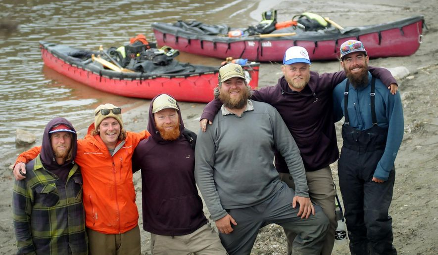 Four Minnesotans and a pair of Iowans made a brief stop in Mankato Wednesday before resuming their 5,200 mile canoe trip from the Gulf of Mexico to the Arctic Ocean. From left are Jarrad Moore, Luke Kimmes, Adam Trigg, John Keaveny, Dan Flynn and Winchell Delano. (AP Photo/Mankato Free Press, John Cross)