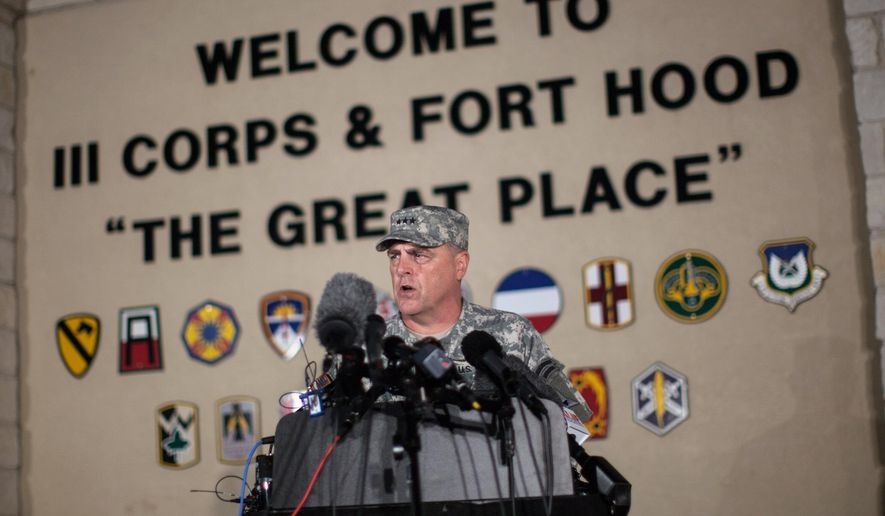 In this April 2, 2014, file photo, Lt. Gen. Mark Milley, commanding general of III Corps and Fort Hood, speaks with the media outside of an entrance to the Fort Hood military base following a shooting that occurred inside, in Fort Hood, Texas. (AP Photo/Tamir Kalifa, File)