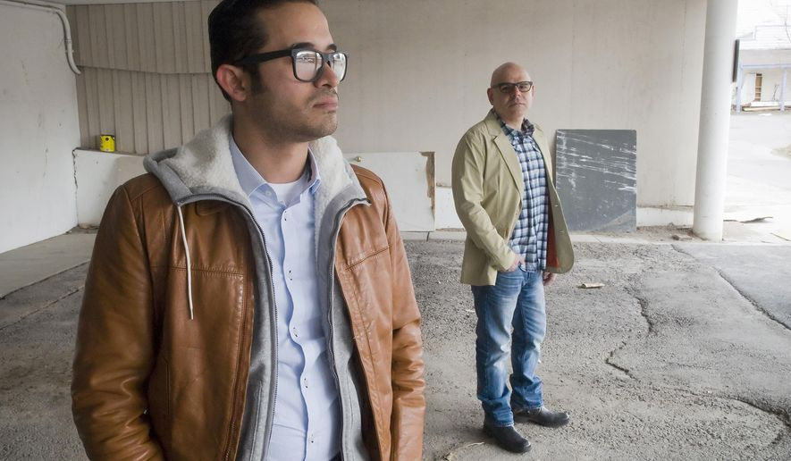 Gerson Giron and Raul Gutierrez stand in the parking garage where Giron slept in his car while homeless in Jackson last summer. Gutierrez produced and directed a short film on Giron's plight, which is a 2015 entry for the Wyoming Short Film Contest. The movie is a proposal for a full-length documentary film examining the employee housing crisis that is contributing to homelessness in Jackson. (AP Photo/Jackson Hole News & Guide, Bradly J. Boner)
