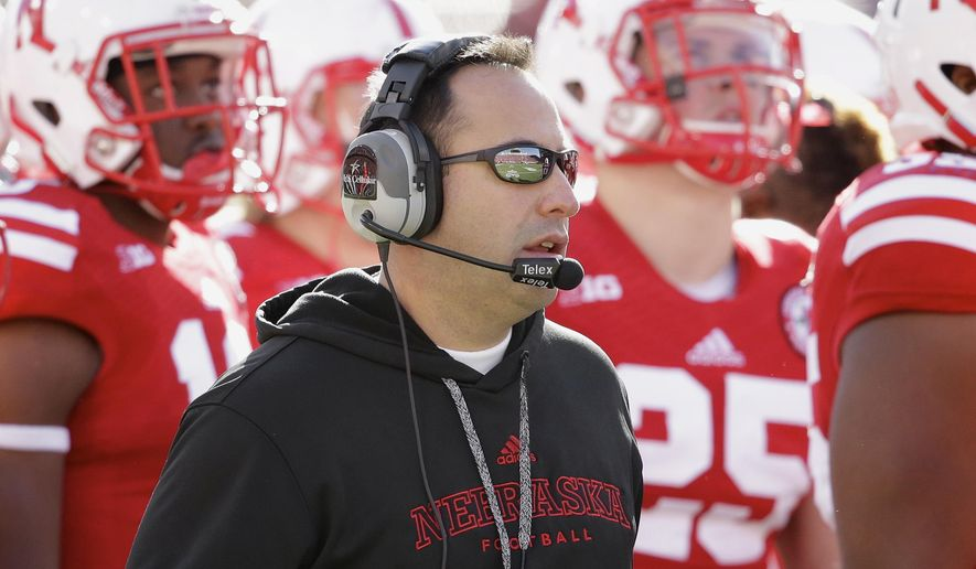FILE - In this Nov. 1, 2014, file photo, Nebraska defensive coordinator John Papuchis stands on the sideline during the first half on an NCAA college football game against Purdue in Lincoln, Neb. UNC has brought in four new defensive coaches, headlined by former Auburn head coach Gene Chizik as defensive coordinator and former Nebraska defensive coordinator John Papuchis as linebackers coach. UNC surrendered more points and total yards last year than at any point in its history, and the new coaches have been installing the foundation of a 4-3 scheme through spring drills. (AP Photo/Nati Harnik)