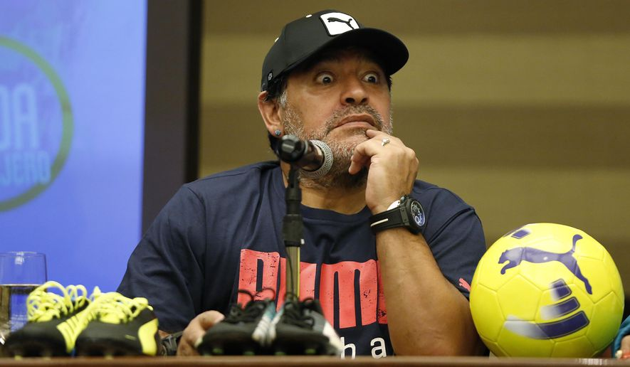 Argentina's soccer legend Diego Armando Maradona gestures as he listens to a question during a press conference in Bogota, Colombia, Thursday, April 9, 2015. Maradona will play tomorrow in an exhibition soccer match in support of peace talks between the Colombian government and legist rebels. (AP Photo/Fernando Vergara)