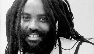 This undated photo shows convicted police killer Mumia Abu-Jamal. A New Jersey teacher has been suspended after she had her third-grade students send get-well cards to the Pennsylvania prison inmate. (Associated Press) **FILE**