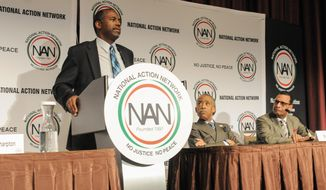 Rev. Al Sharpton, center, and Rev. A.R. Bernard, right, listen as Dr. Ben Carson speaks to a plenary session of the National Action Network Convention 2015 in New York City. (Photo by: Aaron J. / RedCarpetImages.net)
