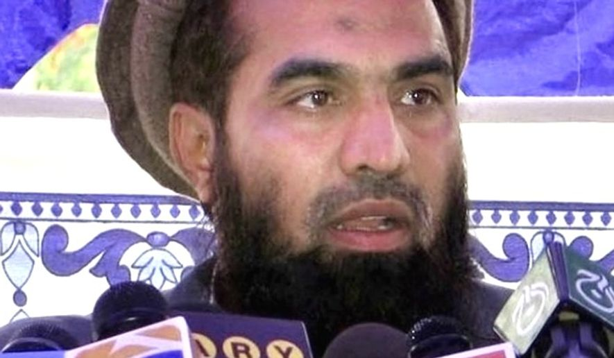 Zaki-ur-Rehman Lakhvi, the suspected mastermind behind the 2008 Mumbai terror attacks that killed 166 people, was released from Pakistani custody on Friday, April 10, 2015. (Associated Press) ** FILE **