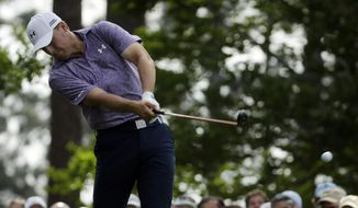 Jordan Spieth tees off on the fourth hole during the second round of the Masters golf tournament Friday, April 10, 2015, in Augusta, Ga. (AP Photo/Chris Carlson)