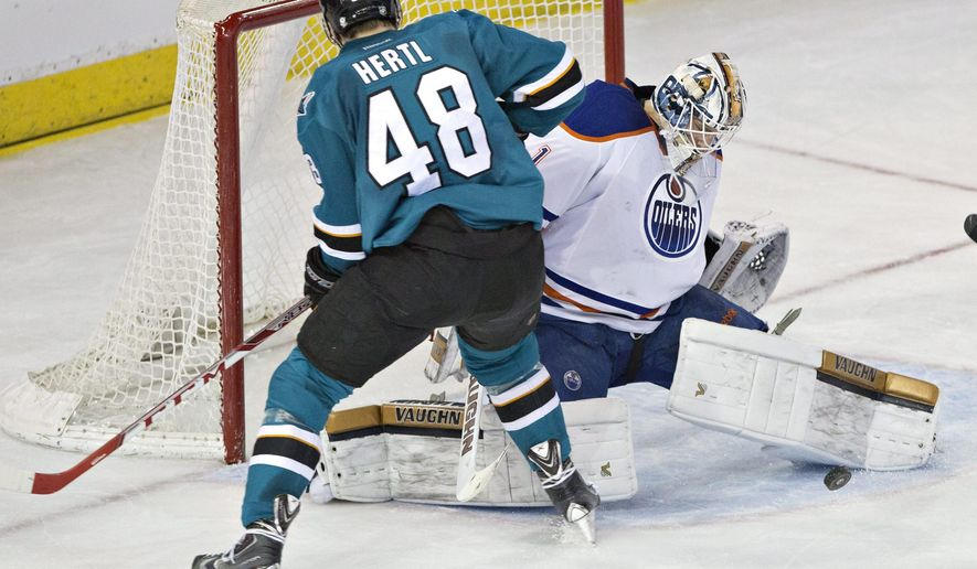 San Jose Sharks Tomas Hertl (48) is stopped by Edmonton Oilers goalie Laurent Brossoit (1) during the second period of an NHL hockey game, Thursday, April 9, 2015 in Edmonton, Alberta.  (AP Photo/The Canadian Press, Jason Franson)