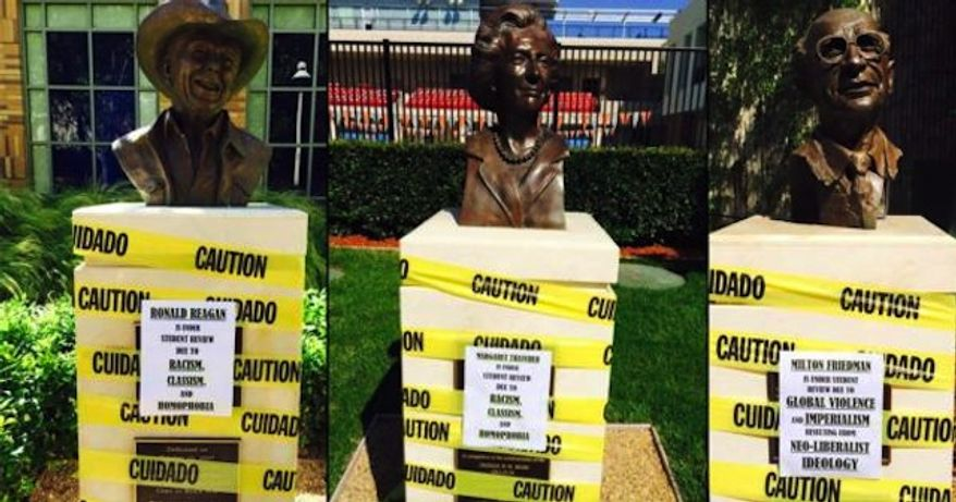 Chapman University says the protest signs that were plastered overnight Wednesday on the busts for conservative icons like Ronald Reagan and Margaret Thatcher can stay, citing the students' right to free speech. (Reddit/TheRealLouisWu)