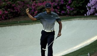 Tiger Woods reacts after a birdie on the 13th hole during the third round of the Masters golf tournament Saturday, April 11, 2015, in Augusta, Ga. (AP Photo/Chris Carlson)