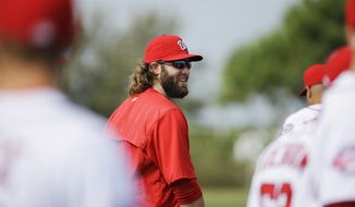 Washington Nationals' Jayson Werth warms up with teammates during a spring training baseball workout, Sunday, March 1, 2015, in Viera, Fla. (AP Photo/David Goldman)