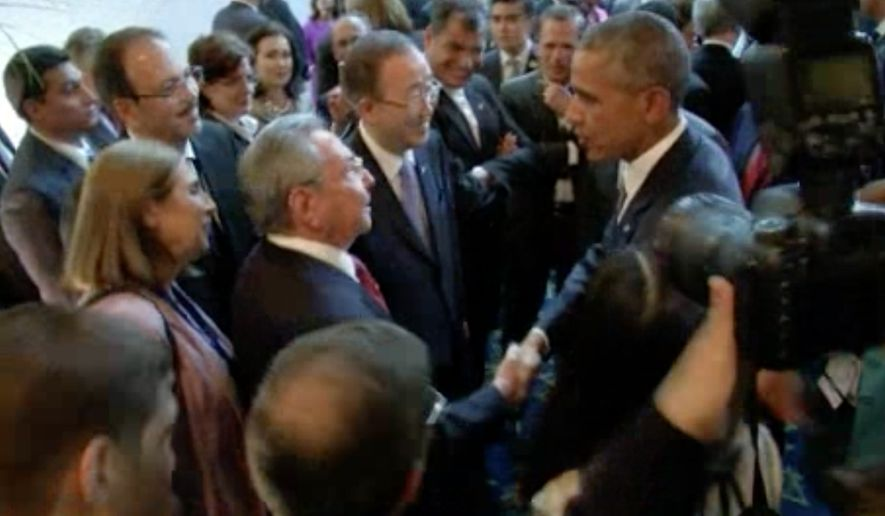 This image from the host broadcaster pool video shows U.S. President Barack Obama and Cuban President Raul Castro exchange handshakes on Friday April 10, 2015, at the opening of the Summit of the Americas in Panama. (AP Photo/Host Broadcaster Pool Video via AP Video)