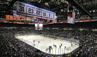 The New York Islanders play against the Columbus Blue Jackets in the first period of the last regular season home game at the Nassau Coliseum on Saturday, April 11, 2015, in Uniondale, N.Y. (AP Photo/Kathy Kmonicek)