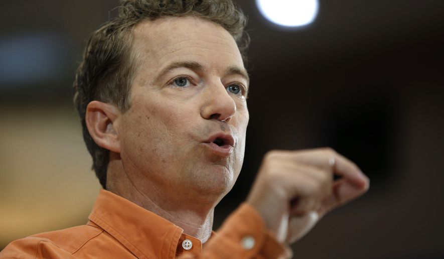 Republican Presidential candidate Sen. Rand Paul, R-Ky., speaks at a rally Saturday, April 11, 2015, in Las Vegas. (AP Photo/John Locher)