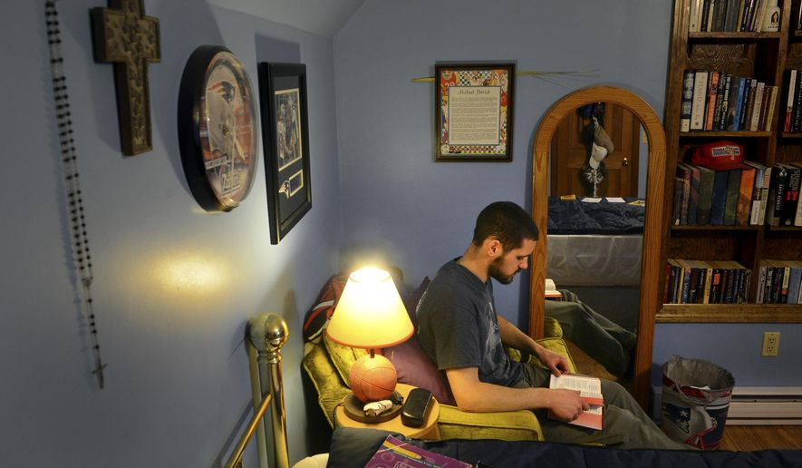 MEMBER FEATURE EXCHANGE FOR APRIL 11 -- In this April 2, 2015 photo, Michael Bovino reads his evening prayers in his room as he enjoys some time with his family at their Stonington, Conn., home while on Easter break from Mount St. Mary's Seminary in Maryland. (AP Photo/The Day, Tim Cook) MANDATORY CREDIT **FILE**