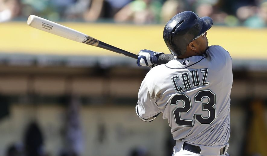 Seattle Mariners' Nelson Cruz swings for a three run home run in the eighth inning of a baseball game against the Oakland Athletics Saturday, April 11, 2015, in Oakland, Calif. (AP Photo/Ben Margot)