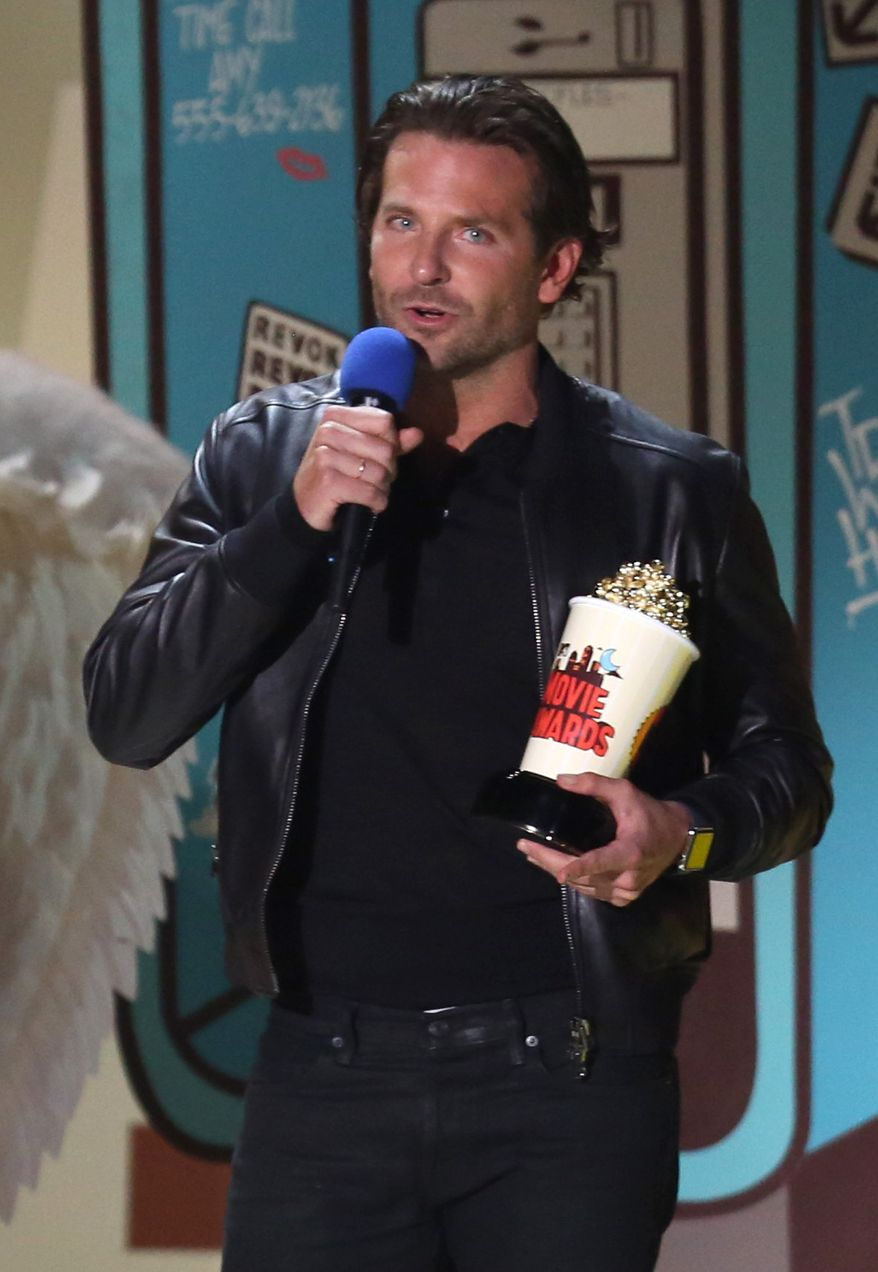 "Bradley Cooper accepts the award for best male performance for ""American Sniper"" at the MTV Movie Awards at the Nokia Theatre on Sunday, April 12, 2015, in Los Angeles. (Photo by Matt Sayles/Invision/AP)"