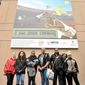 Students from The Duke Ellington School of the Arts pose with the Jesse Owens Mural at The Reeves Center in the District (Focus Features photographs)